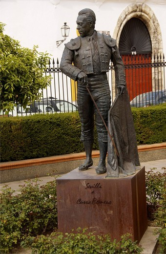 Statue of torero Curro Romero, Francisco Romero López in front of a bullfighting arena, bullring in Seville, Andalusia, Spain : Stock Photo