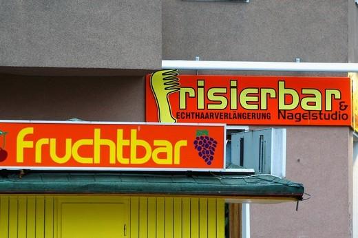 Signs of a hairdresser und a fruitshop : Stock Photo