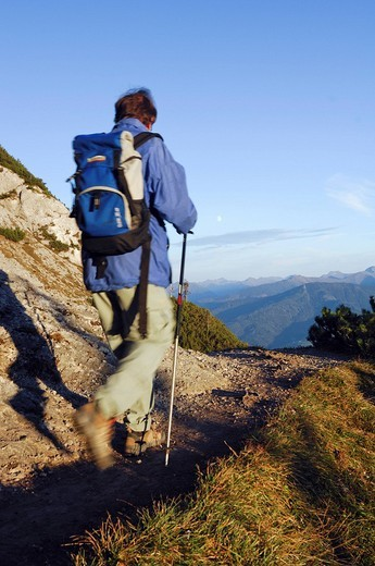 Hiker from behind on the way to the Peace Chapel, Stoderzinken, Styria : Stock Photo