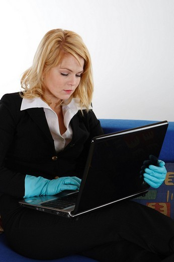 Housewife working on her laptop : Stock Photo