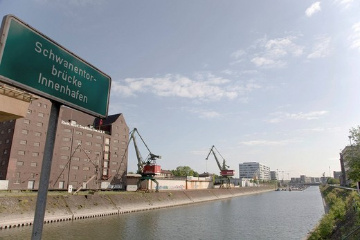 Stock Photo: 1848-253438 Sign reading ´Schwanentorbruecke Innenhafen´, Schwanentorbruecke Bridge basin, service centre, Duisburg, North Rhine_Westphalia, Germany, Europe