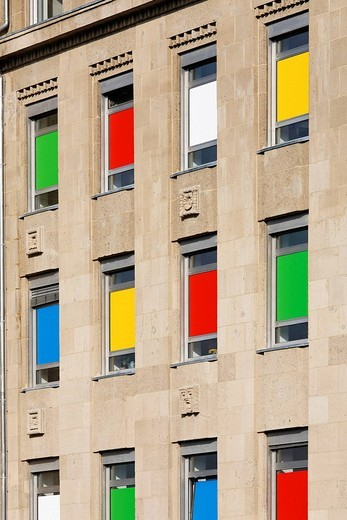 Front windows of a building, sticked with colourful wrappers, Duesseldorf, Germany, : Stock Photo