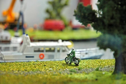 Miniature model, policeman, a motorcycle, channel ship, ship lift Henrichenburg, Westphalian industry museum, Waltrop, channel, Dortmund Ems channel, museum, industry museum, route of the industry culture, NRW, Nordrhein Westphalia, Ruhr district, Germany : Stock Photo