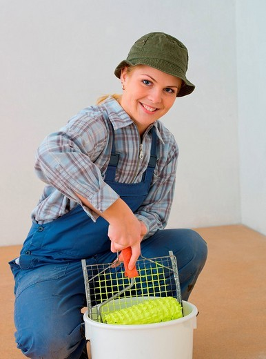 Stock Photo: 1848-255547 Young woman with painting equipment