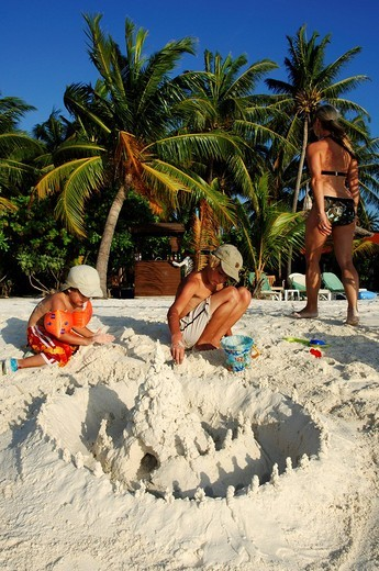 Stock Photo: 1848-255611 Children building a sand castle on the beach, Kurumba Resort, The Maldives, Indian Ocean