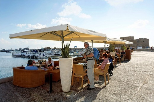 People in a cafe with sun umbrellas at the shore promenade, citadel, Paphos, Pafos, Cyprus, Europe : Stock Photo
