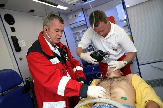DEU Germany : Rescue paramedics in an ambulance truck attempt at resuscitation after a cardiac arrest. Training situation. , : Stock Photo