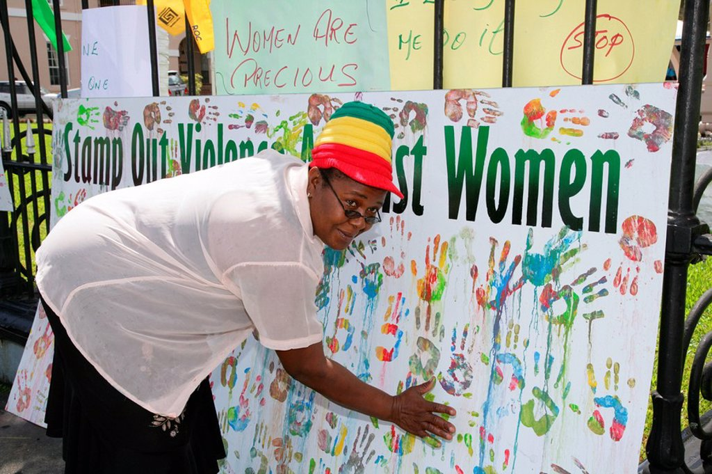 Stock Photo: 1848-256982 Multi_coloured handprints as a symbol of cooperation between people of various ethnic backgrounds during a protest against violence against women in Georgetown, Guyana, South America