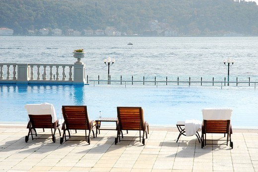 Stock Photo: 1848-258226 Sun loungers and swimming pool, Ciragan Palace Kempinski, luxury hotel on the Bosphorus, Bogazici, Besiktas district, Istanbul, Turkey