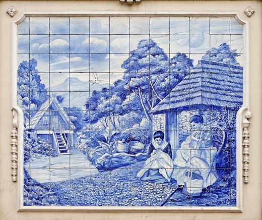 Azulejos showing a rural scene with woman sewing in front of straw covered houses, Funchal, Madeira, Portugal : Stock Photo