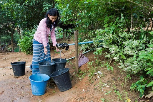 Young woman collecting water at the spring, Mae Ra Camp for Burmese refugees, Maesot, Thailand : Stock Photo