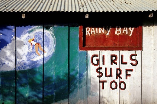 Mural art with a girl surfing, girls surf too, advertisement in La Cahuita, national park, Parque Nacional Cahuita on the Caribbean coast, Caribbean, Costa Rica, Central America : Stock Photo