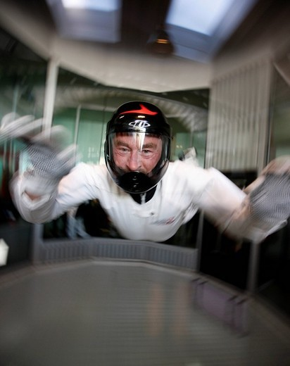 Jochen Schweizer, CEO of the company Jochen Schweizer GmbH, at the Indoor Skydiving Bottrop GmbH, parachute freefall simulation facility, a vertical wind tunnel, largest and most modern in Europe, Bottrop, North Rhine_Westphalia, Germany : Stock Photo