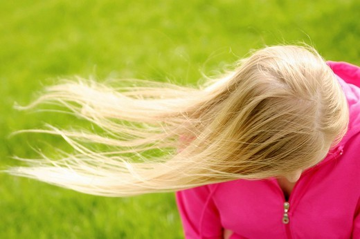 Stock Photo: 1848-259906 The hair of a young blonde woman blow in the wind