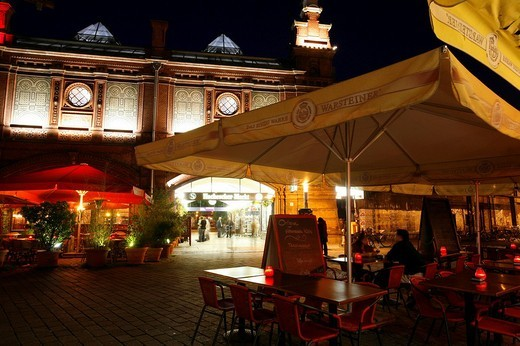 S_Bahnhof Hackescher Markt station with restaurants with outdoor seating at night, Mitte, Berlin, Germany, Europe : Stock Photo
