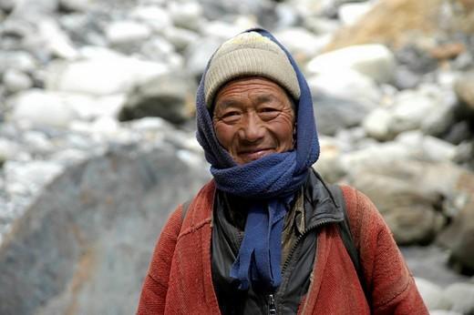 Friendly man wearing traditional coat cap and shawl Nar_Phu Annapurna Region Nepal : Stock Photo