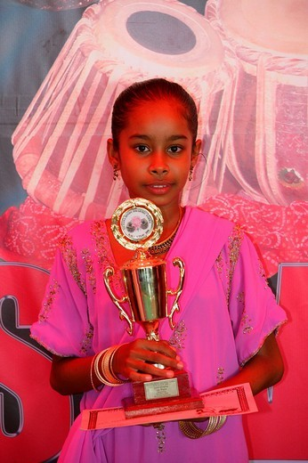 Stock Photo: 1848-26257 Girl of Indian ethnicity holding trophy at a Hindu Festival in Georgetown, Guyana, South America