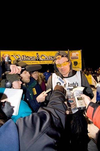 Yukon Quest Sled Dog Race musher Ken Anderson, in an interview after arriving second in Whitehorse, Yukon Territory, Canada : Stock Photo