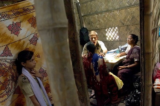 In the outpatient clinic of the Indian aid organization Howrah South Point, Swiss doctor Benjamin Preiswerk treats sick slum dwellers in the name of Doctors for Developing Countries. The doctors do this without payment and sacrifice their annual holidays  : Stock Photo