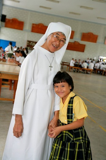 Stock Photo: 1848-26327 Schoolgirl and nun standing in a classroom at an Ursuline convent and orphanage in Georgetown, Guyana, South America