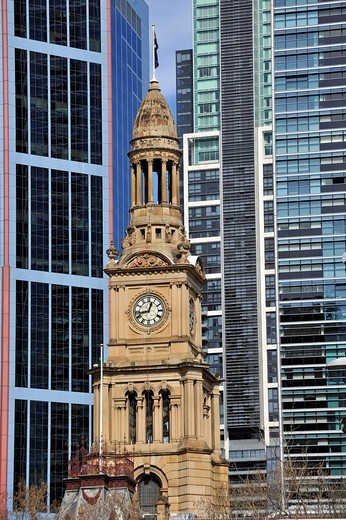 West side of Sydney Town Hall, a Victorian tower, in front of skyscrapers, Sydney, New South Wales, Australia : Stock Photo