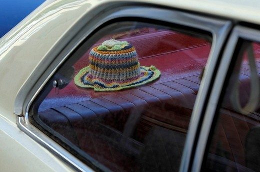Stock Photo: 1848-264585 Crocheted toilet paper hat on the stacking of a vintage car