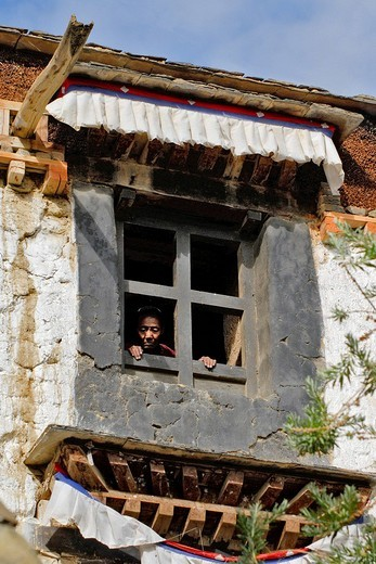 Stock Photo: 1848-264854 Tibetan woman looks through a window, Palcho Monastery or Pelkor chode or Shekar, Gyantse, Tibet