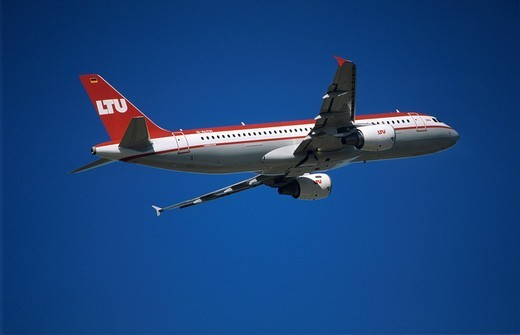LTU airlines Airbus A320 shortly after take off, blue sky : Stock Photo