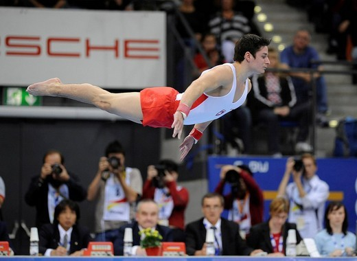 Nicolas Boeschenstein, Switzerland, performing on the floor in front of the judges and press photographers, Gymnastics World Cup Stuttgart 2008, Baden_Wuerttemberg, Germany, Europe : Stock Photo