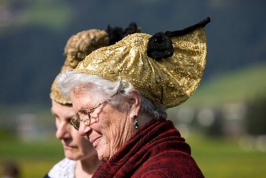 Women wearing golden bonnets at the Gauderfest 2008 Festival, Zell am Ziller, Zillertal Valley, North Tyrol, Austria, Europe : Stock Photo