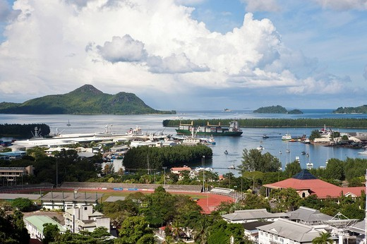 View from Bel Air towards the capital city of Victoria and the international harbour, at back the islands St. Anne, Ile au Cerf, Ile Moyenne, Ile Ronde und Ile Longue, Mahe Island, Seychelles, Indian Ocean, Africa : Stock Photo