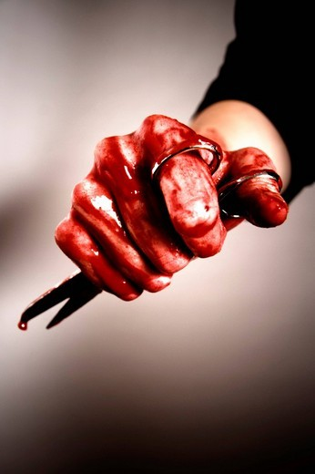 Bloody hand with scissors : Stock Photo