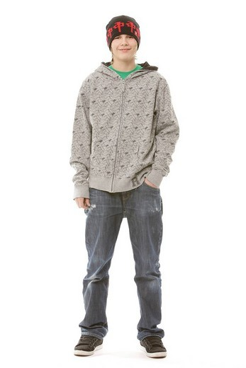 13_year_old boy wearing a cool outfit, smiling : Stock Photo