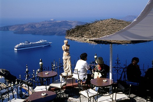 Bar cafe terrace with view of the caldera, capital city Fira at the crater rib of the volcano, Island of Santorini, Thera or Thira, Cyclades, the Aegean, Mediterranean Sea, Greece, Europe : Stock Photo