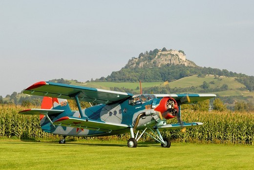 Stock Photo: 1848-26778 Legendary Russian multi_purpose fighter plane and largest double_decker aircraft in the world, Antonov An_2, in front of Hohentwiel, Konstanz district, Baden_Wuerttemberg, Germany, Europe