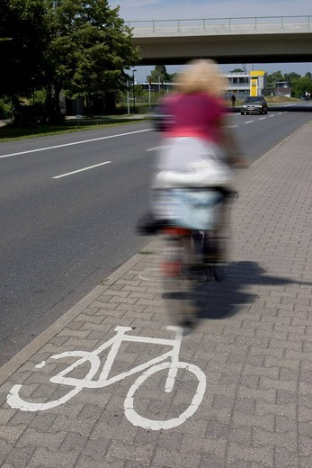 Stock Photo: 1848-269305 Cyclist riding on a bike lane with a bike lane street marking