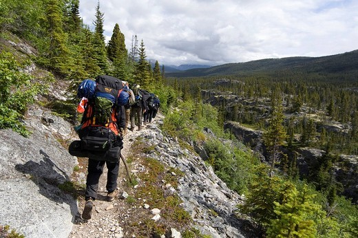 Group of alpinists descending to Lake Lindeman, Chilkoot Pass/Trail, Klondike Gold Rush, British Columbia, B.C., Canada, North America : Stock Photo