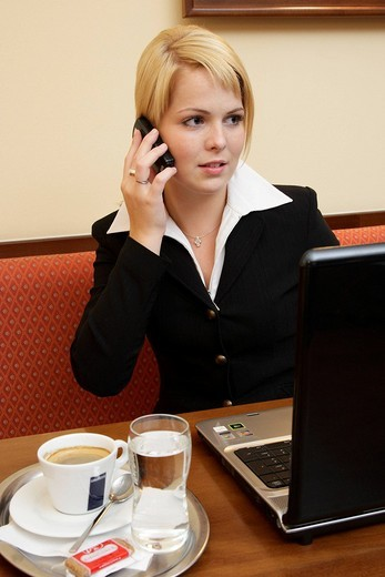 Young business woman is using a mobile phone : Stock Photo