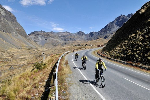Mountainbikers descending a street, Downhill Biking, Deathroad, Altiplano, La Paz, Bolivia, South America : Stock Photo
