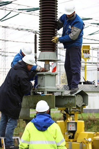 Stock Photo: 1848-271600 Workers doing maintenance work in a transformer station of the ELE, Emscher Lippe Energie GmbH, a subsiduary of the RWE, Marl, North Rhine_Westphalia, Germany, Europe