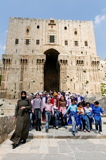 School class in front of the citadel, Aleppo, Syria, Middle East, Asia : Stock Photo