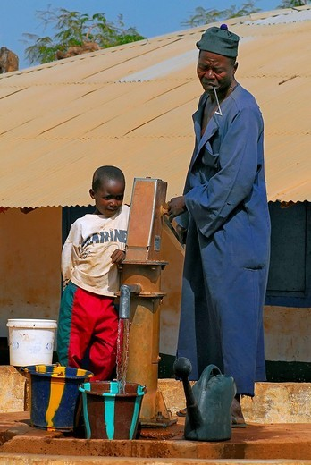 Stock Photo: 1848-272093 Father and son pumping water, Tumami Tenda, The Gambia, Africa