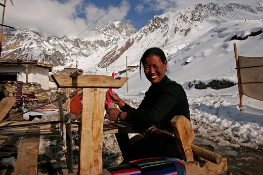 Stock Photo: 1848-272162 Woman weaving textiles in the pilgrim village of Muktinath, Nepal, Asia