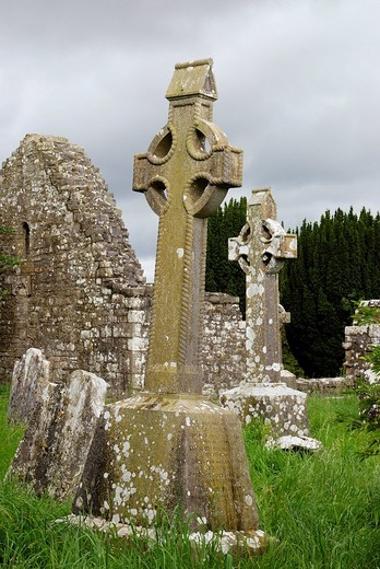 Inclined celtic style highcrosses mounted on remains of old monastary near Slim Co Meath Ireland : Stock Photo