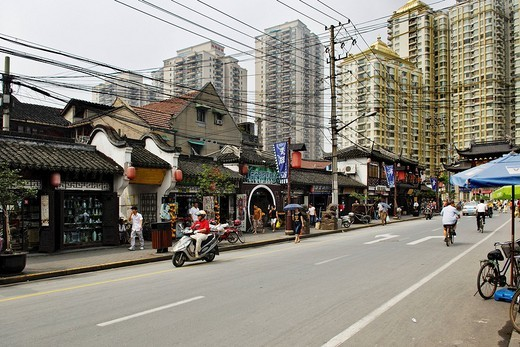 Street in the old part of Shanghai, cable chaos, little shops, traffic, new housing blocks, Shanghai, China, Asia : Stock Photo