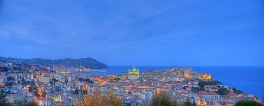 Panorama exposure, night exposure of Imperia, Oneglia and Porto Maurizio districts with classical cathedral, Riviera dei Fiori, Liguria, Italy, Europe : Stock Photo