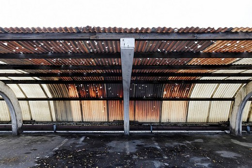 Corrugated roof made of plastic, holes caused by hail, brown colouring caused by factory fumes, factory parking place in the industrial area, Rhine Harbour Krefeld_Uerdingen, North Rhine_Westphalia, Germany, Europe : Stock Photo