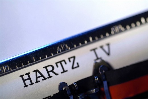 The word Hartz IV on a sheet of paper in an old typewriter : Stock Photo