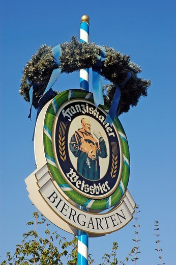 Sign with advertisement for Franziskaner wheat beer, beergarden : Stock Photo