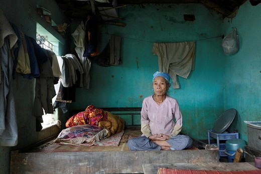 Stock Photo: 1848-30191 Quack Thi Thih, 71, in her home almost completly destroyed by a flood, Lien Hoa, Hoa Bin Province, Vietnam, Asia